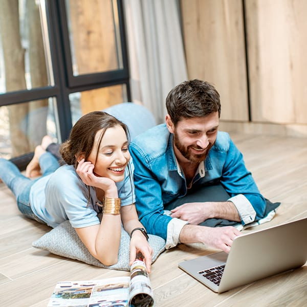 Young couple looking at properties online